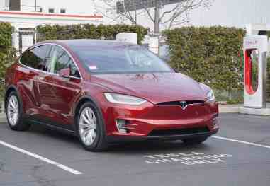 Model X in Signature Red